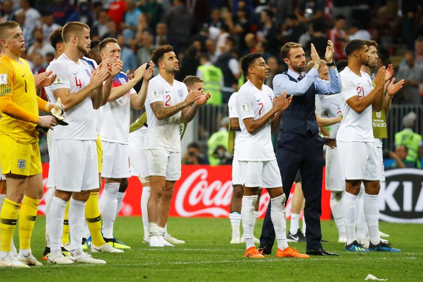 England applauding their fans after defeat