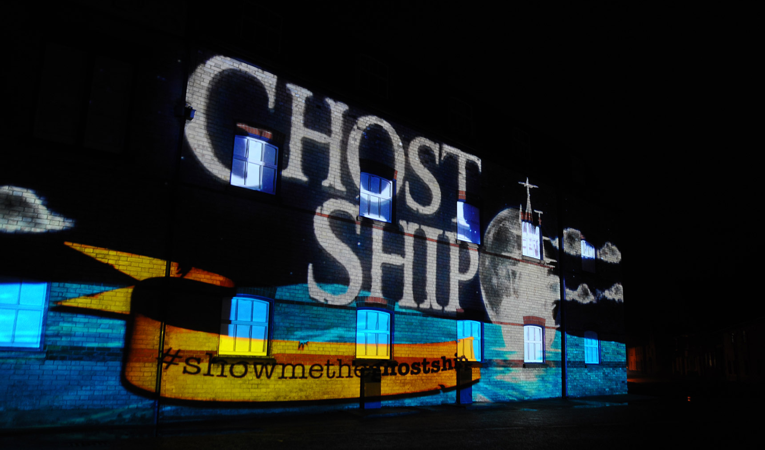 Adnams Ghost Ship projection on the side of the brewery