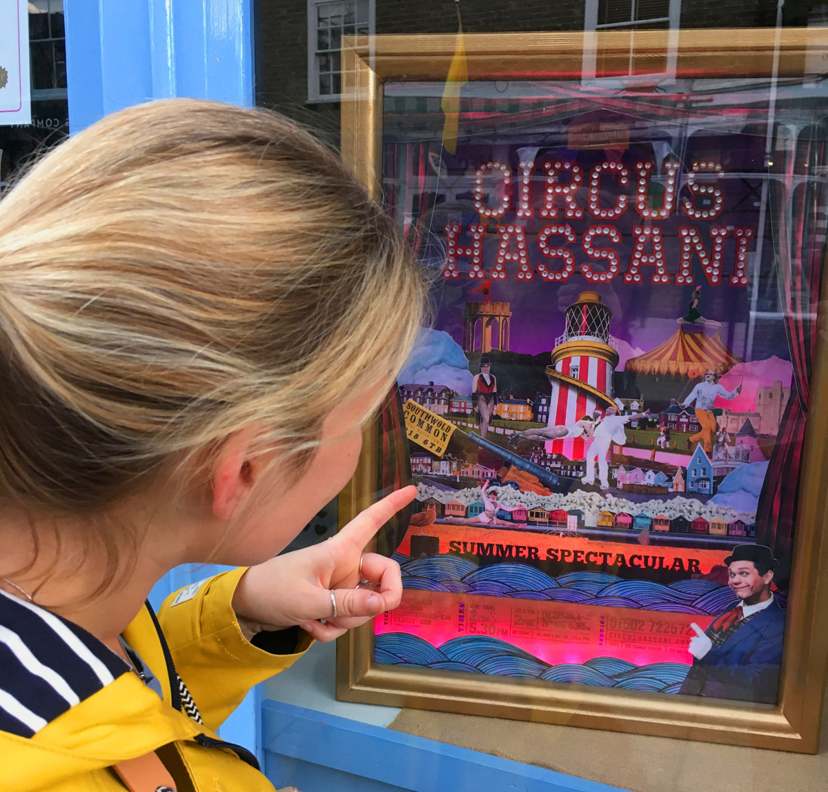 circus hassani living poster in a shop window